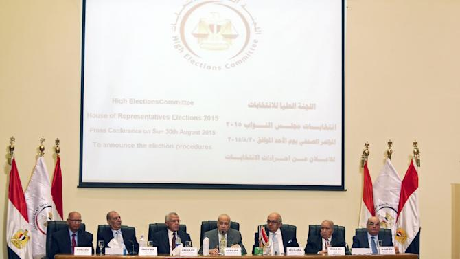 Members of the High Elections Committee attend a news conference in Cairo, Egypt