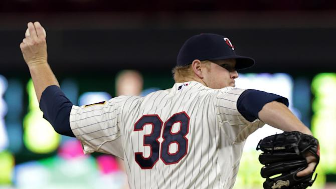 Minnesota Twins starting pitcher Logan Darnell throws against the Cleveland Indians in a baseball game, Saturday, Sept. 20, 2014, in Minneapolis. (AP Photo/Jim Mone)