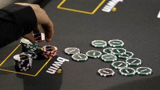 Betting company Bwin Interactive Entertainment AG logo is pictured with chips on a poker table during an event in Paris