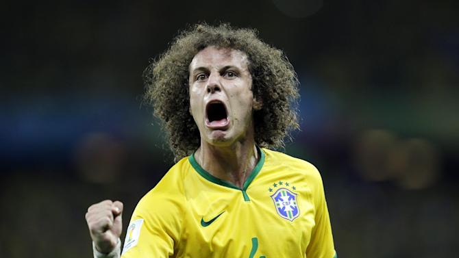 Brazil's David Luiz celebrates after scoring his side's second goal on a free kick during the World Cup quarterfinal soccer match between Brazil and Colombia at the Arena Castelao in Fortaleza, Brazil, Friday, July 4, 2014. (AP Photo/Natacha Pisarenko)