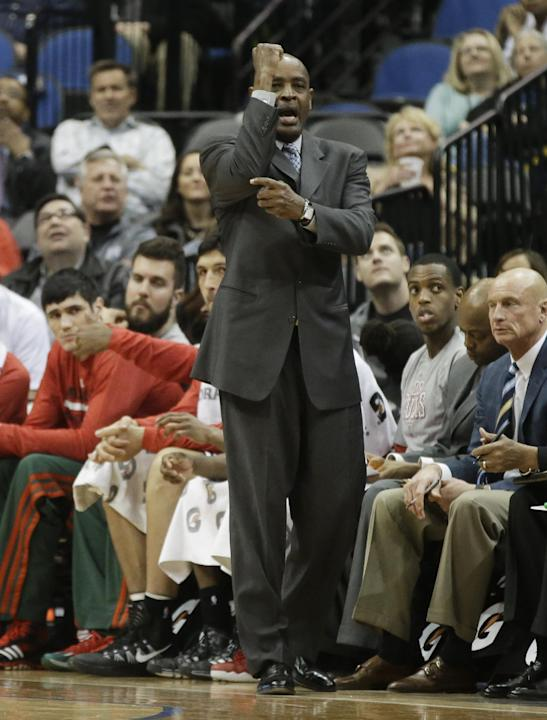 Milwaukee Bucks head coach Larry Drew signals his team in the second half of an NBA basketball game against the Minnesota Timberwolves, Tuesday, March 11, 2014, in Minneapolis. The Timberwolves won 11