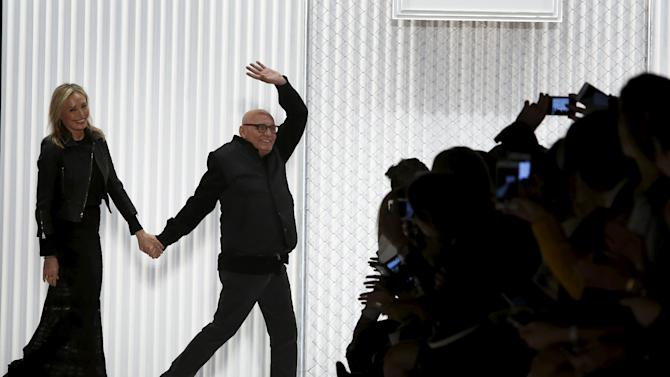 Designers Lubov and Max Azria acknowledge attendees following the Herve Leger By Max Azria Fall/Winter 2016 collection presentation at New York.