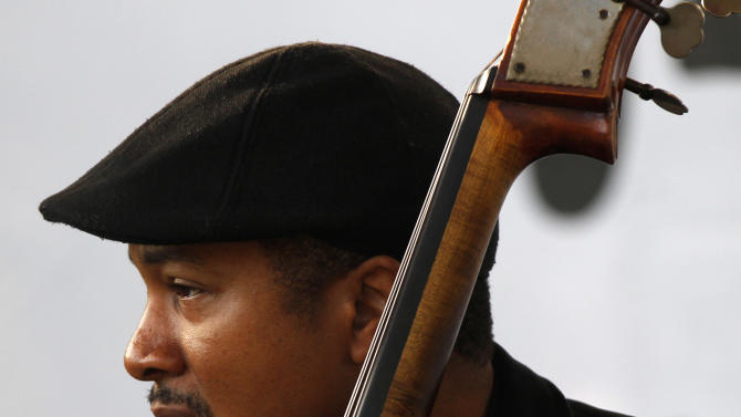 Bassist Roland Guerin performs at a sunrise concert marking International Jazz Day in New Orleans, Monday, April 30, 2012. The performance, at Congo Square near the French Quarter, is one of two in the United States Monday; the other is in the evening in New York. Thousands of people across the globe are expected to participate in International Jazz Day, including events in Belgium, France, Brazil, Algeria and Russia. (AP Photo/Gerald Herbert)