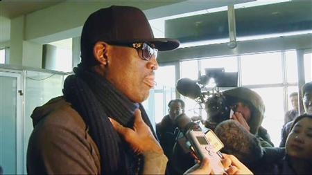 Former U.S. NBA basketball player Dennis Rodman speaks to the media at the airport before departing Pyongyang