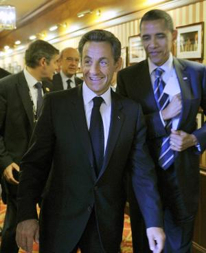 US President Barack Obama, right, and French President Nicolas Sarkozy arrive for a bilateral meeting at the G8 summit in Deauville, France, Friday, May 27, 2011. G8 leaders, in a two-day meeting, will discuss the Internet, aid for North African states and ways in which to end the conflict in Libya. (AP Photo/Philippe Wojazer, Pool)