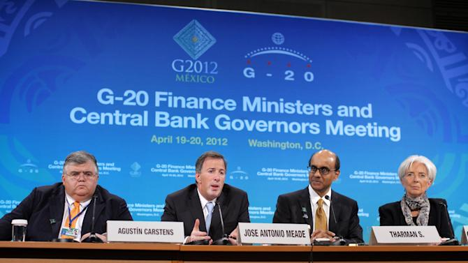 From left, Mexico's Central Bank Gov. Agustin Carstens, Mexico's Finance Minister Jose Antonio Meade, International Monetary and Finance Committee (IMFC) Chairman Tharman Shanmugaratnam, and IMF Managing Director Christine Lagarde take part in a G-20 news conference at the IMF and World Bank Group Spring Meetings in Washington, Friday, April 20, 2012. (AP Photo/Charles Dharapak)