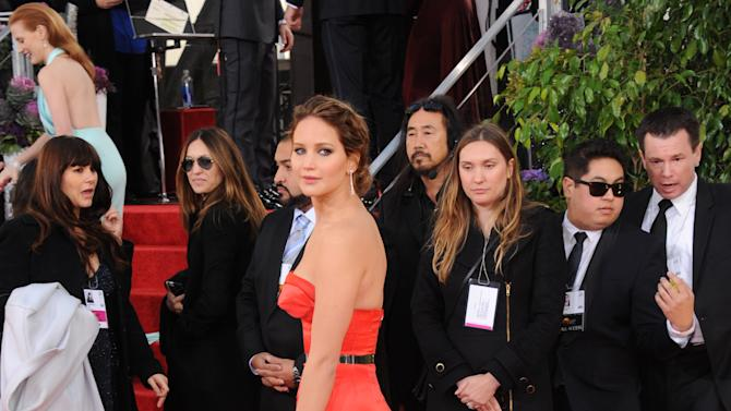 Actress Jennifer Lawrence arrives at the 70th Annual Golden Globe Awards at the Beverly Hilton Hotel on Sunday Jan. 13, 2013, in Beverly Hills, Calif. (Photo by Jordan Strauss/Invision/AP)