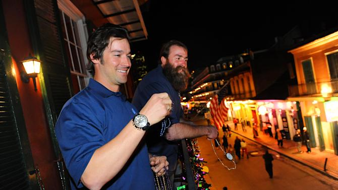 "IMAGE DISTRIBUTED FOR HEAD & SHOULDERS - Head & Shoulders new ""Mane Man"" L.A. Angels pitcher C.J. Wilson and Pittsburgh Steelers Brett Keisel celebrated the launch of new Head & Shoulders with Old Spice by throwing Mardi Gras beads on Bourbon Street from the balcony of famed Pat O'Brien's surrounding Super Bowl XLVII on Wednesday, Jan. 30, 2013 in New Orleans, LA. (Photo by Cheryl Gerber/Invision for Head & Shoulders/AP Images)"
