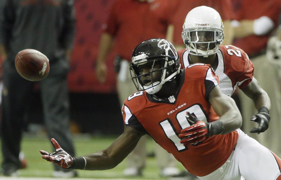 Atlanta Falcons wide receiver Drew Davis (19) prepares to make the catch against the Arizona Cardinals defensive back Michael Adams (27) during the second half of an NFL football game Sunday, Nov. 18, 2012, in Atlanta. (AP Photo/John Bazemore)