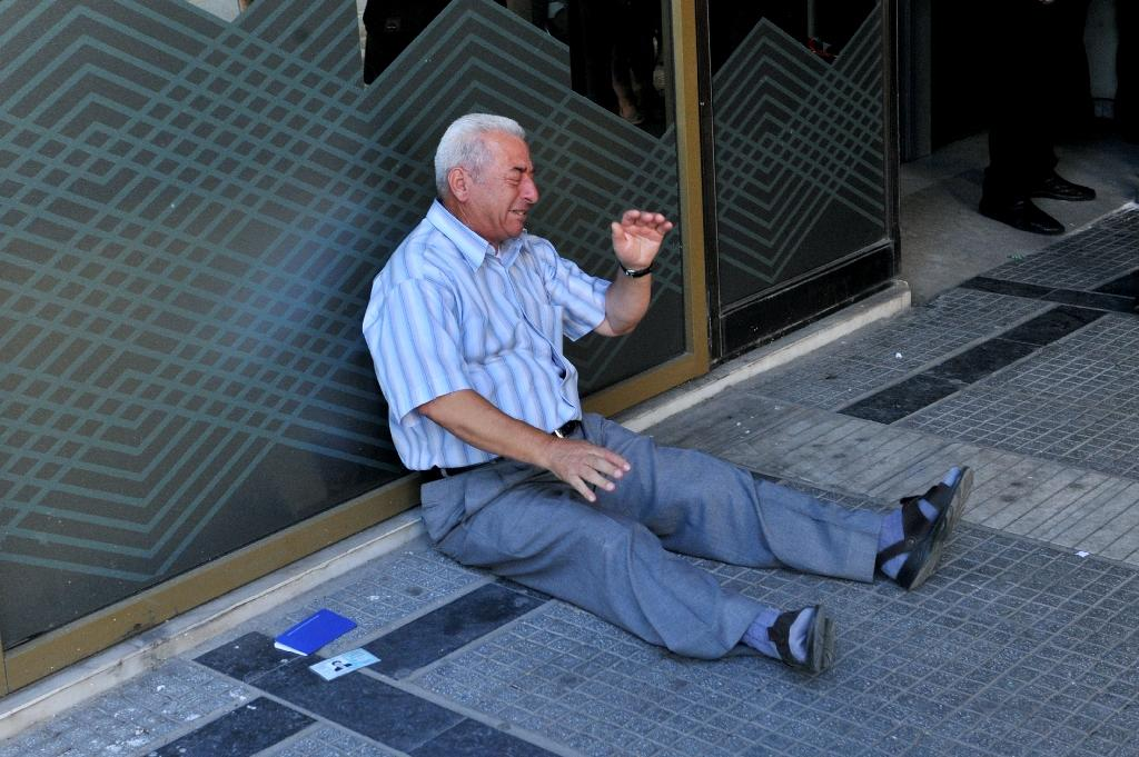 Crying Greek pensioner: the story behind the poignant photo