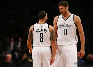 Nets beat Raptors 107-100 in Brooklyn debut
