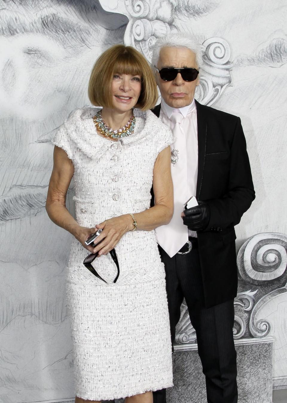 Fashion designer Karl Lagerfeld, right, and editor-in-chief of American Vogue Anna Wintour arrive for the Chanel Women's Fall Winter 2013 haute couture fashion collection in Paris, France, Tuesday, July 3, 2012. (AP Photo/Francois Mori)