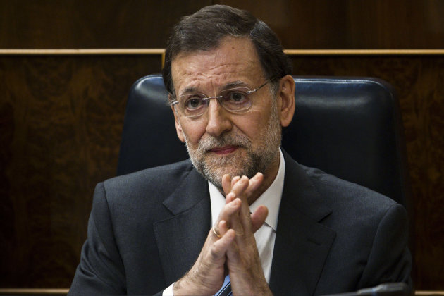 Spain's Prime Minister Mariano Rajoy attends a control session at the Spanish Parliament, in Madrid, Wednesday, June 13, 2012. The interest rate Spain would have to pay to raise money on the world's b