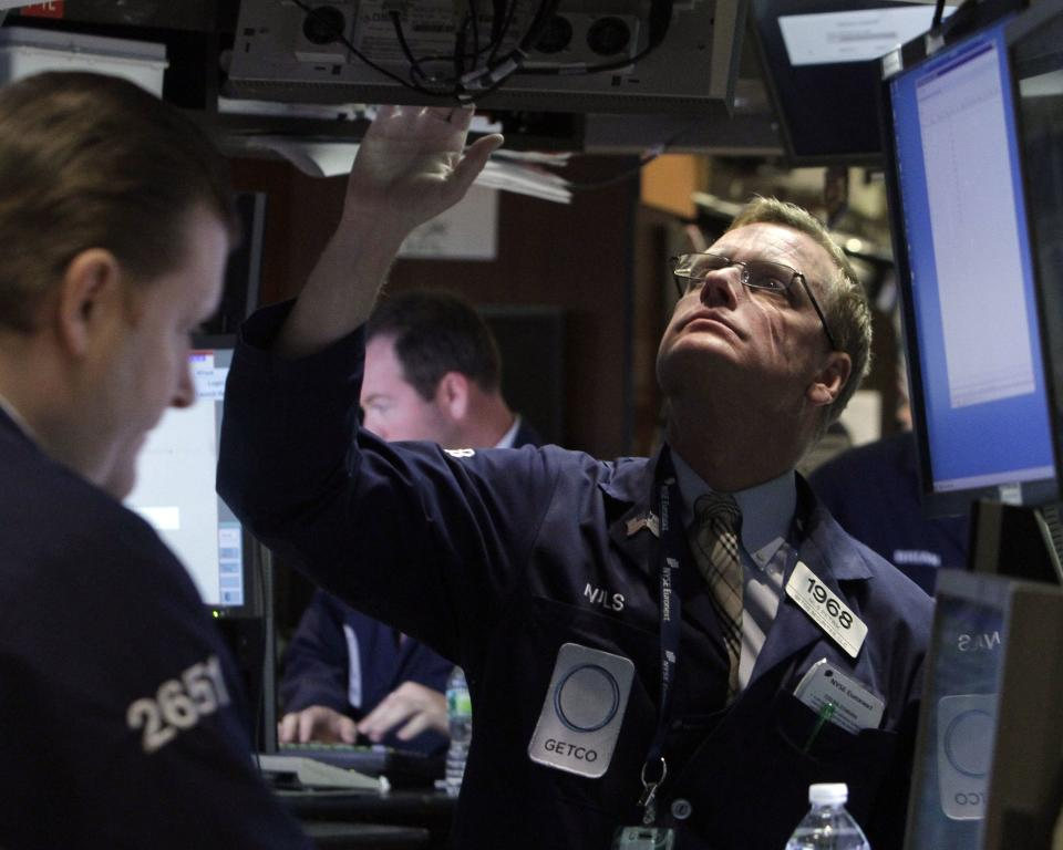 Specialist Nils Petrik works on the floor of the New York Stock Exchange Monday, Aug. 22, 2011. (AP Photo/Richard Drew)