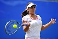Austria's Tamira Paszek hits a shot against France's Marion Bartoli during their singles match at the AEGON International tournament in Eastbourne. Paszek won 4-6, 7-5, 6-4
