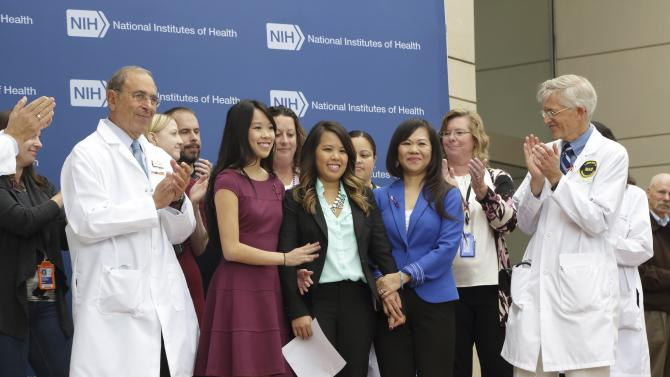 Handout of Dallas nurse Nina Pham flanked by her sister Cathy and her mother Diana during a news conference at the National Institutes of Health (NIH) in Bethesda