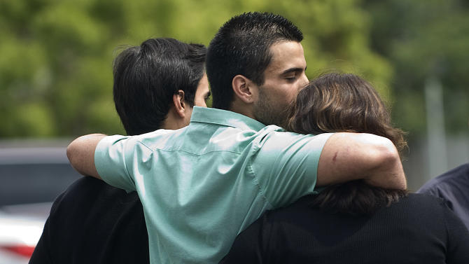 Andres Cendoya, from left, his brother Nicolas Cendoya and their mom head to their Costa Mesa home after Nicholas was released from Mission Hospital in Mission Viejo, Calif., on Sunday, April 7, 2013. He and friend Kyndall Jack were lost while hiking on Easter Sunday in Trabuco Canyon. (AP Photo/The Orange County Register, Cindy Yamanaka) MANDATORY CREDIT, EUGENE GARCIA, ORANGE COUNTY REGISTER MAGS OUT LA TIMES OUT