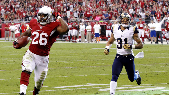 Arizona Cardinals running back Beanie Wells (26) scores a touchdown ahead of St. Louis Rams cornerback Cortland Finnegan (31) during the first half of an NFL football game, Sunday, Nov. 25, 2012, in Glendale, Ariz. (AP Photo/Ross D. Franklin)
