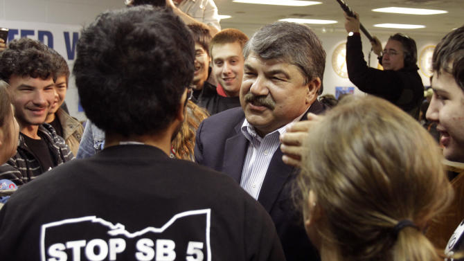 FILE - In this Nov. 7, 2012 file photo, AFL-CIO President Richard Trumka, center, speaks with supporters at a union hall in Cleveland before a door-to-door campaign to urge a no vote on Ohio Issue 2. Unions spent $24 million to overturn the anti-union measure in Ohio, only to lose their effort to recall Wisconsin Gov. Scott Walker the following June. Blindsided by a new law weakening union rights in Michigan, organized labor is preparing to target Republican governors in politically important states up for re-election in 2014. (AP Photo/Mark Duncan, File)