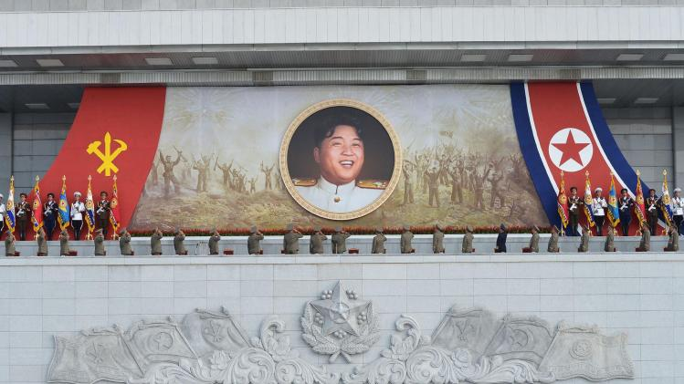 Military personnel salute a portrait of North Korean leader Kim during an event marking the 61st anniversary of the armistice that ended the Korean War