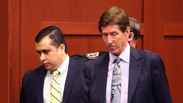 "George Zimmerman, defendant in the killing of Trayvon Martin, arrives with his attorney Mark O'Mara, right, for a pre-trial hearing, Tuesday, April 30, 2013 in Seminole circuit court, in Sanford, Fla.  Zimmerman, the former neighborhood watch leader,  told Circuit Judge Debra Nelson that he agrees with his defense attorneys' decision not to seek an immunity hearing under the state's ""Stand Your Ground"" self-defense law.  Zimmerman has pleaded not guilty, claiming self-defense. Martin was fatally shot in February 2012 during a fight with Zimmerman in a Sanford gated community.  (AP Photo/Orlando Sentinel, Joe Burbank, Pool)"