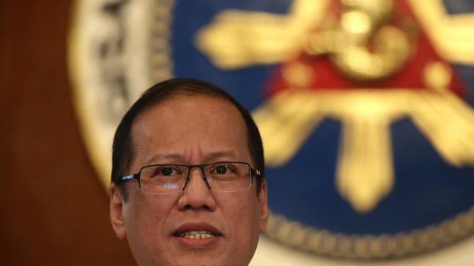 """Philippine President Benigno Aquino III talks about the current standoff between a Filipino Muslim clan, who occupied a village in Lahad Datu, Sabah State in Malaysia, and Malaysian forces during a news conference at Malacanang Palace in Manila Monday March 4, 2013 in Manila, Philippines. The standoff resulted in a firefight Friday and Sunday that resulted in the death of at least ten of the Sulu Sultanate """"Royal Army"""" followers and two Malaysian forces. Malaysia sent hundreds of soldiers to a Borneo state Monday to help neutralize armed Filipinos who allegedly have killed 8 police officers in the country's bloodiest security emergency in years. (AP Photo/Bullit Marquez)"""