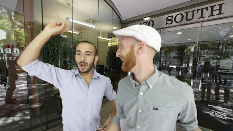Plaintiffs Moudi Sbeity, left, and his partner Derek Kitchen, one of three couples who brought a lawsuit against Utah's gay marriage ban, celebrate as they arrive at their lawyer's office in Salt Lake City on Wednesday, June 25, 2014. A federal appeals court on Wednesday ruled for the first time that states must allow gay couples to marry, finding the Constitution protects same-sex relationships and putting a remarkable legal winning streak across the country one step closer to the U.S. Supreme Court. (AP Photo/Rick Bowmer)
