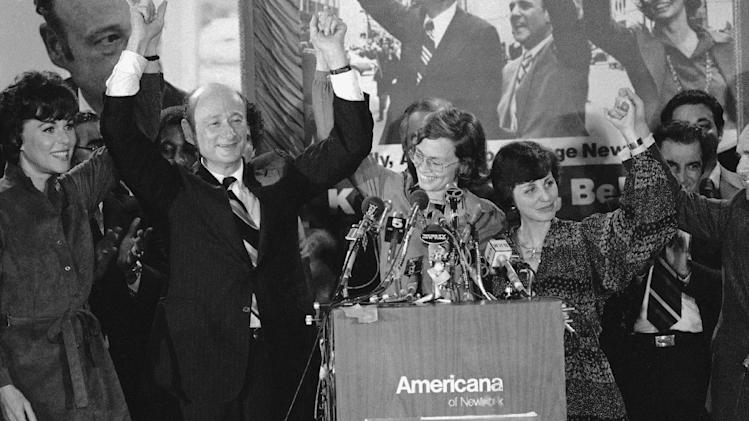 FILE - In this Nov. 8, 1977 file photo, Rep. Edward Koch, second from left, raises hands with Bess Myerson, left, Carol Bellamy, center Diana Goldin, second from right, and her husband Harrison Goldin at a Midtown New York Hotel. Koch was elected New York City Mayor, Miss Bellamy was elected city council President and Goldin was re-elected city comptroller. Koch, the combative politician who rescued the city from near-financial ruin during three City Hall terms, has died at age 88. Spokesman George Arzt says Koch died Friday morning Feb. 1, 2013 of congestive heart failure. (AP Photo/Ray Stubblebine, File)