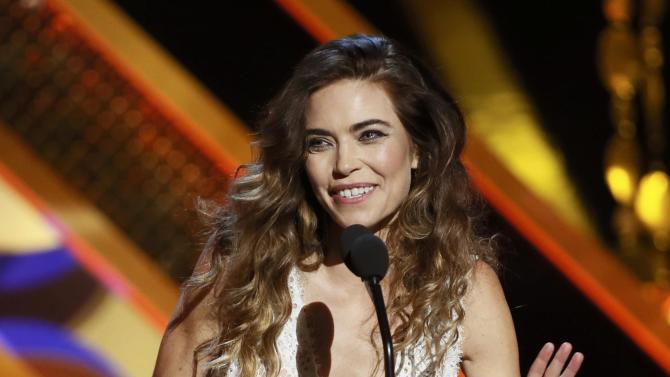 "Actress Amelia Heinle accepts the award for Outstanding Supporting Actress in a Drama Series for her role on ""The Young and the Restless"" at the 42nd Annual Daytime Emmy Awards in Burbank"