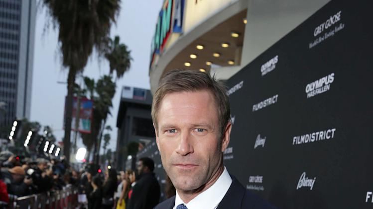 Aaron Eckhart at FilmDistrict's Premiere of 'Olympus Has Fallen' hosted by Brioni and Grey Goose at the ArcLight Hollywood, on Monday, March, 18, 2013 in Los Angeles. (Photo by Eric Charbonneau/Invision for FilmDistrict/AP Images)
