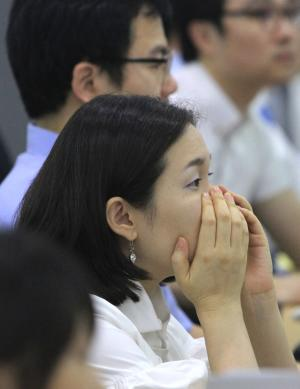 A currency trader watches monitors at the Korea Exchange Bank headquarters in Seoul, South Korea, Tuesday, Aug. 9, 2011. Asian equity markets were sharply down early Tuesday as investors fearing a possible global economic slowdown continued to flee stocks. (AP Photo/Ahn Young-joon)
