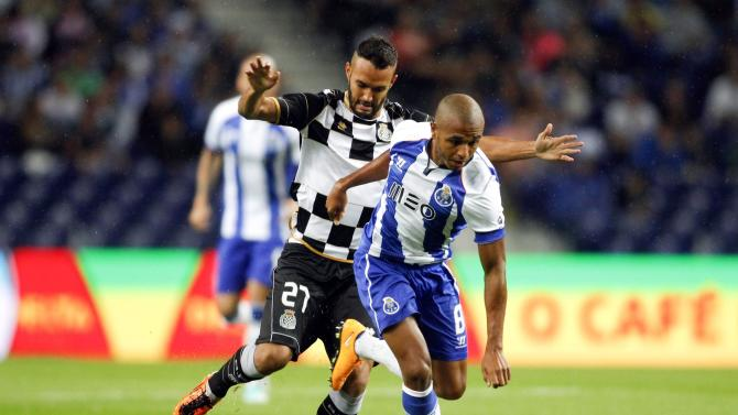 Porto's Brahimi fights for the ball with Boavista's Anderson Carvalho during their Portuguese Premier League soccer match at the Dragao stadium in Porto