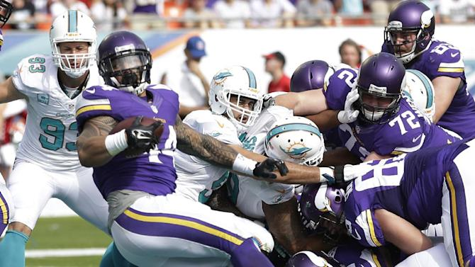 Dolphins rally past Vikings 37-35; Philbin to keep job