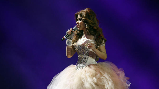 FILE - In this March 1, 2013 file photo, Mexican singer Gloria Trevi performs at the Vina del Mar International Song Festival in Vina del Mar, Chile. Trevi will perform at the first Latin American Music Awards  on Oct. 8.  (AP Photo/Luis Hidalgo, File)