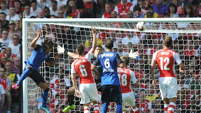 Monaco's Radamel Falcao (L) scores past Arsenal goalkeeper Wojciech Szczesny during their Emirates Cup football match between Arsenal and AS Monaco at Emirates Stadium in North London, England on August 3, 2014
