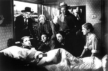 Top: Frank Morgan , Charley Grapewin , Bert Lahr .  Bottom: Judy Garland , Ray Bolger , Jack Haley and Clara Blandick in The Wizard Of Oz