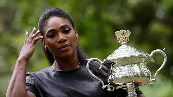 Serena Williams of the U.S. poses with her Australian Open trophy, the day after defeating Russia's Maria Sharapova in the women's singles final at the Australian Open tennis championship in Melbourne, Australia, Sunday, Feb. 1, 2015. (AP Photo/Rob Griffith)
