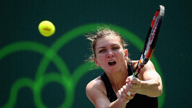 Simona Halep of Romania plays a backhand against Nicole Vaidisova of Czech Republic in their second round match during the Miami Open on March 27, 2015 in Key Biscayne, Florida