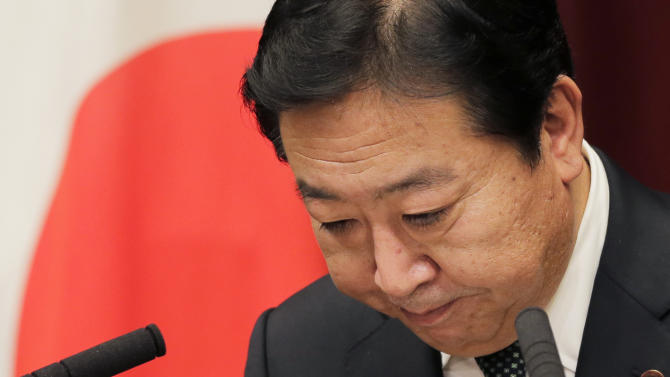 Japan's Prime Minister Yoshihiko Noda bows after a press conference at his official residence in Tokyo Friday, Nov. 16, 2012. Noda dissolved the lower house of parliament earlier in the day, paving the way for elections in which his ruling party will likely give way to a weak coalition government divided over how to solve Japan's myriad problems. Elections were set for Dec. 16. (AP Photo/Koji Sasahara)