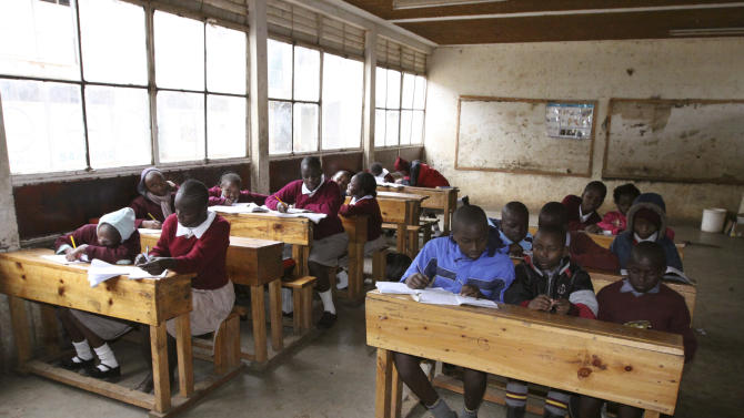 Pupils at the Toi Primary School in Nairobi, Kenya, Tuesday Sept. 6, 2011,  sit in a classroom and study without a teacher, because the teachers are on strike.  The chairman of the Kenya National Union of Teachers says 200,000 teachers in schools have started a strike to protest the diversion of funds meant to hire more teachers and ease classroom overcrowding, in a move expected to affect more than 10 million children.(AP Photo/Khalil Senosi)