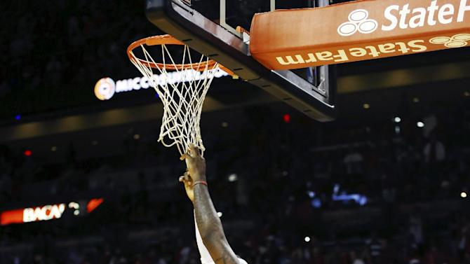 Miami Heat's LeBron James hangs onto the net during the final minute of an NBA basketball game against the Oklahoma City Thunder in Miami, Tuesday, Dec. 25, 2012. The Heat won 103-97. (AP Photo/J Pat Carter)