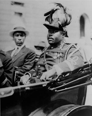 "FILE - In this Aug. 1922 file photo, Marcus Garvey is shown in a military uniform as the ""Provisional President of Africa"" during a parade on the opening day of the annual Convention of the Negro Peoples of the World at Lenox Avenue in Harlem, New York City. A century ago, Garvey helped spark movements from African nationalist independence to American civil rights to self-sufficiency in black commerce. Jamaican students in every grade from kindergarten through high school have began studying the teachings of the 1920-era black nationalist leader in a new mandatory civics program in schools across this predominantly black country of 2.8 million people. (AP Photo/File)"