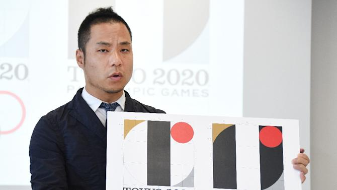 Tokyo Olympic logo designer Kenjiro Sano explains his design during a press conference at the headquarters of Tokyo 2020 on August 5, 2015