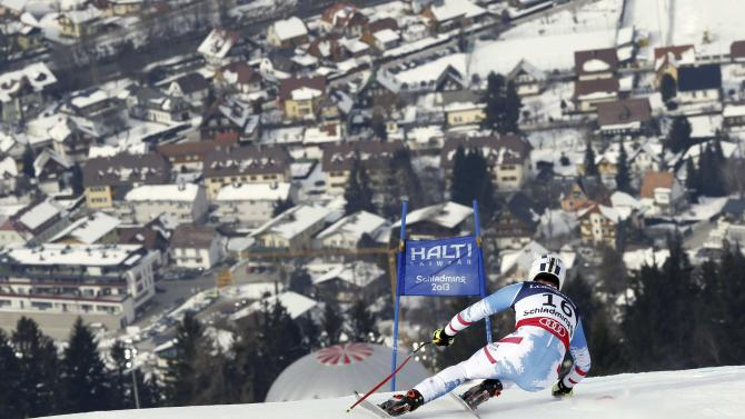 Austria's Romed Baumann speeds down the course during the downhill portion of the men's super-combined, at the Alpine skiing world championships in Schladming, Austria, Monday, Feb.11, 2013. (AP Photo/Alessandro Trovati)