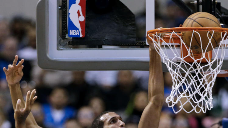 Dallas Mavericks' Brandan Wright, rear, goes up for a dunk attempt that rimmed out over Sacramento Kings' James Johnson, center front, in the first half of an NBA basketball game Wednesday, Feb. 13, 2013, in Dallas. (AP Photo/Tony Gutierrez)