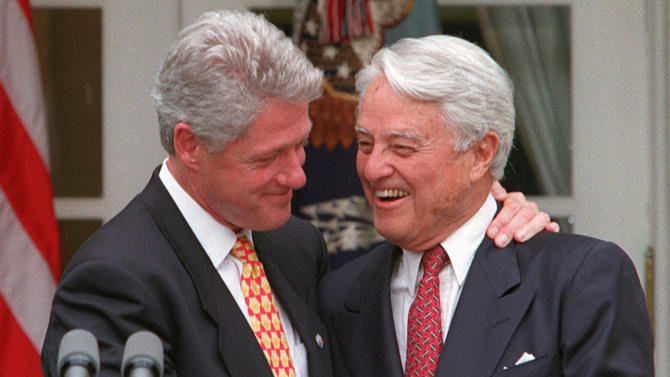 """FILE - In this June 19, 1996 file photo, President Clinton embraces R. Sargent Shriver in the Rose Garden of the White House Wednesday June 19, 1996 during a ceremony to honor the 35th anniversary of the Peace Corps. Shriver was named the first director of the Peace Corps by President John F. Kennedy. Shriver, the exuberant public servant and Kennedy in-law whose singular career included directing the Peace Corps, fighting the """"War on Poverty"""" and, less successfully, running for office, died Tuesday, Jan. 18, 2011.  He was 95.   (AP Photo/Ruth Fremson, File)"""