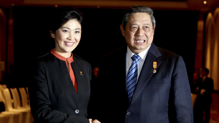 Indonesian President Susilo Bambang Yudhoyono, left, greets Thai Prime Minister Yingluck Shinawatra, left, during their bilateral meeting in Nusa Dua, Bali, Indonesia, Thursday, Nov. 8, 2012. (AP Photo/Firdia Lisnawati)