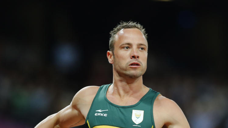 FILE - In this Wednesday, Sept. 5, 2012 file photo, South Africa's Oscar Pistorius wins the Men's 4 x 100 Relay T42-46 final at the 2012 Paralympics in London. Pistorius has been arrested after a 30-year-old woman was shot dead at his home in South Africa, early Thursday, Feb. 14, 2013. (AP Photo/Emilio Morenatti, File)