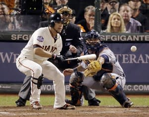 San Francisco Giants' Gregor Blanco bunts to load the bases during the seventh inning of Game 2 of baseball's World Series against the Detroit Tigers, Thursday, Oct. 25, 2012, in San Francisco. (AP Photo/Charlie Riedel)