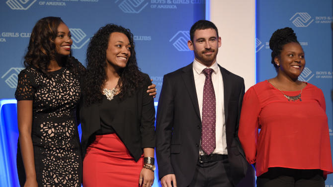 IMAGE DISTRIBUTED FOR BOYS & GIRLS CLUB OF AMERICA - Former Youths of the Year, from left, Kiana Knolland (2013-14), Trei Dudey (2012-13), Nick Foley (2011-12) and Mona Dixon (2010-11) make a surprise appearance to recognize national sponsor Tupperware Brands and Rick and Susan Goings at Boys & Girls Clubs of America's 67th Annual National Youth of the Year Celebration, Tuesday, Sept. 16, 2014, in Washington DC. The inspirational event celebrated six outstanding teen Club members vying for the National Youth of the Year title and $61,000 in scholarships from Tupperware Brands and the Rick and Susan Goings Foundation. (Nick Wass/Ap Images for Boys & Girls Clubs of America)